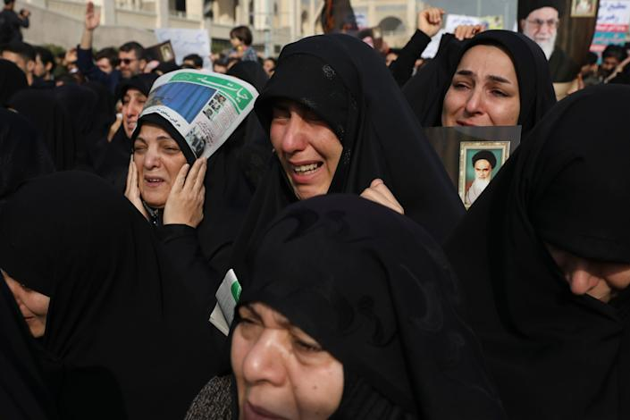 Women weep while mourning during a demonstration over the U.S. airstrike in Iraq that killed Iranian Revolutionary Guard Gen. Qasem Soleimani, in Tehran, Iran, Jan. 3, 2020.