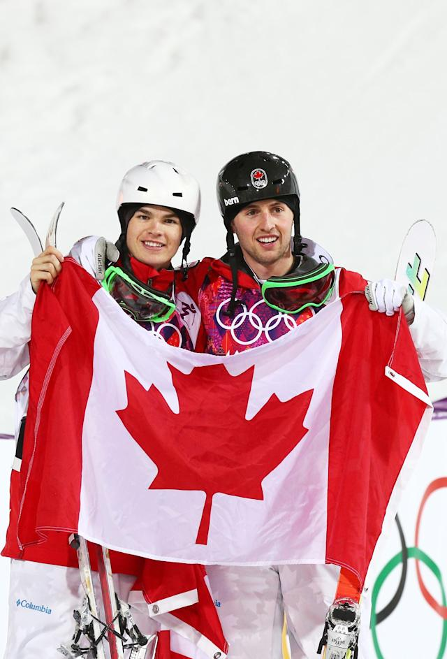 SOCHI, RUSSIA - FEBRUARY 10: Gold medalist Alex Bilodeau of Canada (R) celebrates with silver medalist Mikael Kingsbury of Canada after the Men's Moguls Finals on day three of the Sochi 2014 Winter Olympics at Rosa Khutor Extreme Park on February 10, 2014 in Sochi, Russia. (Photo by Cameron Spencer/Getty Images)