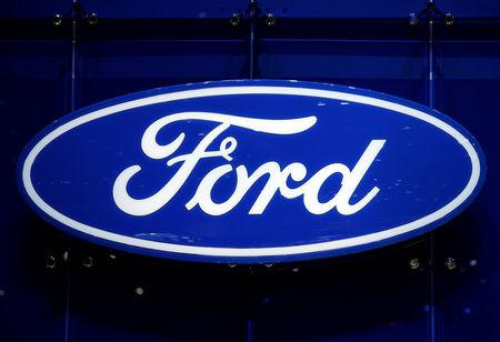 FILE PHOTO: The Ford logo is pictured on the company's stand during the 88th Geneva International Motor Show in Geneva, Switzerland, March 7, 2018. REUTERS/Denis Balibouse