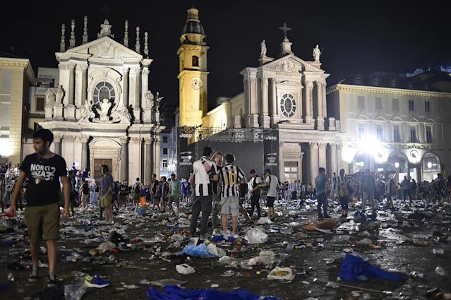 <p>San Carlo Square is seen as Juventus' fan run away following panic created by the explosion of firecrackers as they was watching the match on a giant screen on June 3, 2017. (Giorgio Perottino/Reuters) </p>