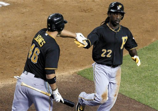 Pittsburgh Pirates' Andrew McCutchen (22) gets a high-five from teammate Garrett Jones (46) after scoring a run against the Arizona Diamondbacks during the third inning of a baseball game Tuesday, April 17, 2012, in Phoenix. (AP Photo/Ross D. Franklin)