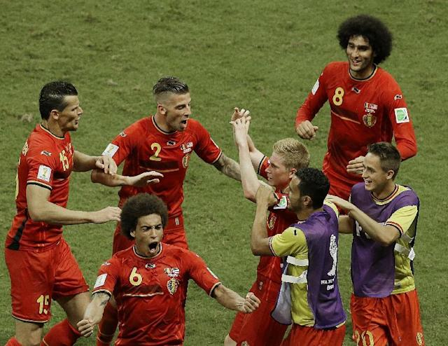 Belgium's Kevin De Bruyne, center right, celebrates scoring the opening goal during the World Cup round of 16 soccer match between Belgium and the USA at the Arena Fonte Nova in Salvador, Brazil, Tuesday, July 1, 2014. (AP Photo/Themba Hadebe)