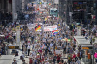 "Thousands march along the 'Friedrichstrasse' during the demonstration against corona measures in Berlin, Germany, Saturday, Aug. 1, 2020. The initiative ""Querdenken 711"" has called for this. The motto of the demonstration is ""The end of the pandemic - Freedom Day"". (Christoph Soeder/dpa via AP)"