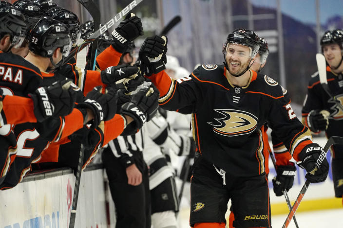 Anaheim Ducks defenseman Kevin Shattenkirk celebrates his goal with teammates during the first period of an NHL hockey game against the Los Angeles Kings Monday, March 8, 2021, in Anaheim, Calif. (AP Photo/Mark J. Terrill)