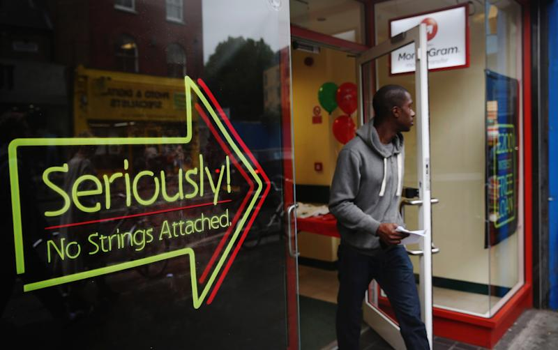 LONDON, ENGLAND - OCTOBER 03: A man walks out of a payday loan store in Dalston on October 3, 2013 in London, England. Payday loan stores are to face tougher regulations after moves proposed by the Financial Conduct Authority (FCA) call on more responsible lending. (Photo by Dan Kitwood/Getty Images)