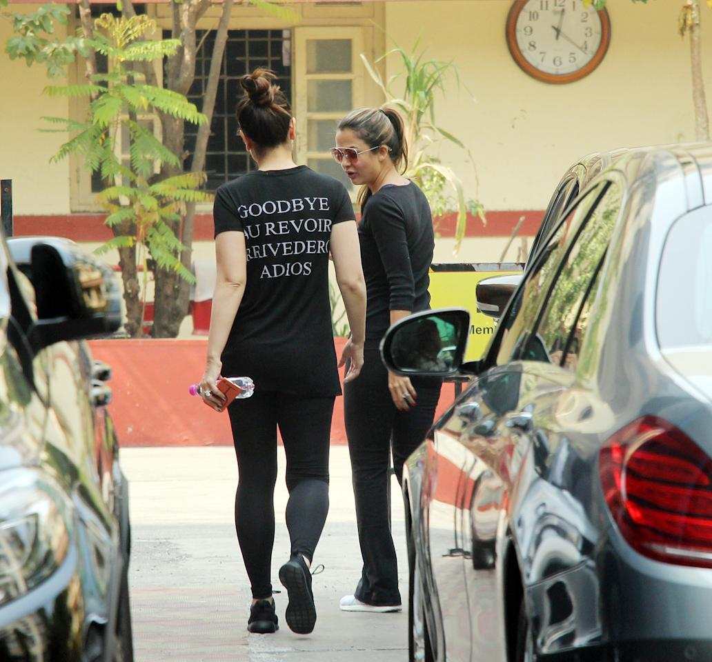 <p>As the actress stepped out of her car and headed inside the gym, the back of her T-shirt, revealed another special message. Just like the front, Bebo's T-shirt, on the back, read, 'Goodbye, Au Revoir, Arrivederci, Adios.' </p>