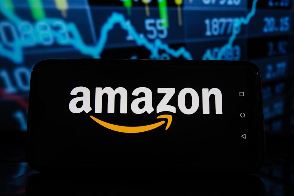 POLAND - 2021/04/08: In this photo illustration an Amazon  logo seen displayed on a smartphone with stock market percentages in the background. (Photo Illustration by Omar Marques/SOPA Images/LightRocket via Getty Images)