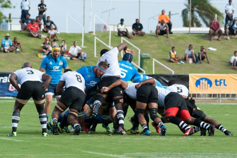Fiji's and Italy's players take part in a scrum during their international rugby union Test match in Suva, on June 17, 2017