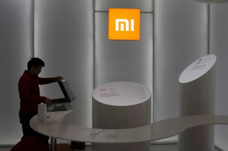 FILE PHOTO: Booth of Chinese smartphone maker Xiaomi is seen at an industrial design expo in Wuhan