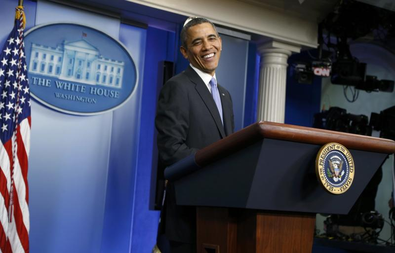 U.S. President Obama reacts during year-end news conference in the White House briefing room in Washington