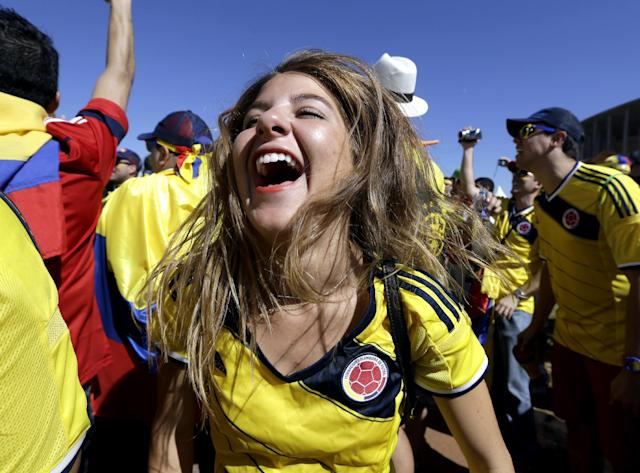 A Colombian supporter reacts before the start of the group C World Cup soccer match between Colombia and Ivory Coast at the Estadio Nacional in Brasilia, Brazil, Thursday, June 19, 2014. (AP Photo/Sergei Grits)