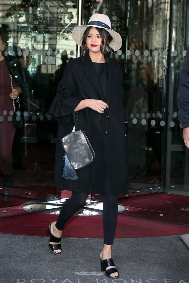 <p>In a Yohji Yamamoto oversized ruffle sleeved cotton coat and The Row clutch</p>