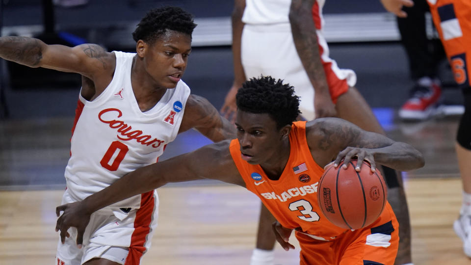 Syracuse forward Kadary Richmond (3) drives on Houston guard Marcus Sasser (0) in the first half of a Sweet 16 game in the NCAA men's college basketball tournament at Hinkle Fieldhouse in Indianapolis, Saturday, March 27, 2021. (AP Photo/AJ Mast)