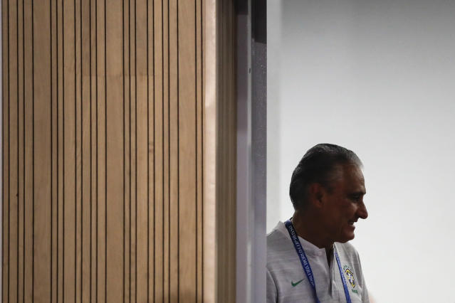 Brazil head coach Tite arrives to a press conference after Brazil's official training on the eve of the group E match between Brazil and Switzerland at the 2018 soccer World Cup in the Rostov Arena in Rostov-on-Don, Russia, Saturday, June 16, 2018. (AP Photo/Felipe Dana)