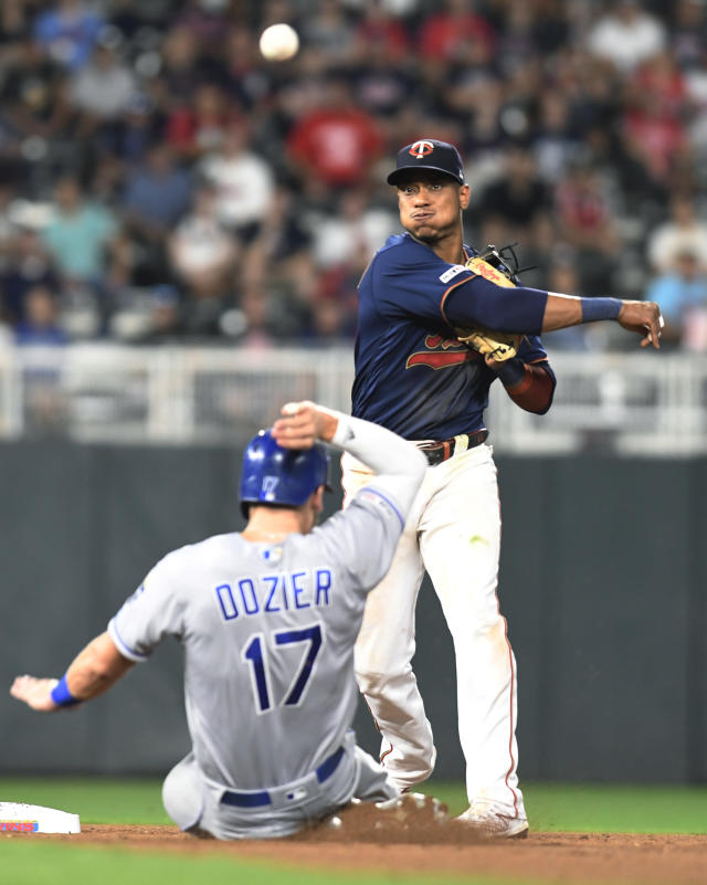 Minnesota Twins shortstop Jorge Polanco throws to first after forcing out Kansas City Royals' Hunter Dozier (17) during the sixth inning of a baseball game Saturday, Sept. 21, 2019, in Minneapolis. Alex Gordon was out at first. Kansas City won 12-5. (AP Photo/Tom Olmscheid)