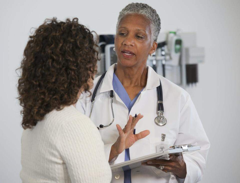 "<span class=""caption"">Because of coronavirus, you can expect changes when visiting the doctor.</span> <span class=""attribution""><a class=""link rapid-noclick-resp"" href=""https://www.gettyimages.com/detail/photo/doctor-talking-to-patient-in-doctors-office-royalty-free-image/135539177?adppopup=true"" rel=""nofollow noopener"" target=""_blank"" data-ylk=""slk:Getty Images / Ariel Skelley"">Getty Images / Ariel Skelley</a></span>"