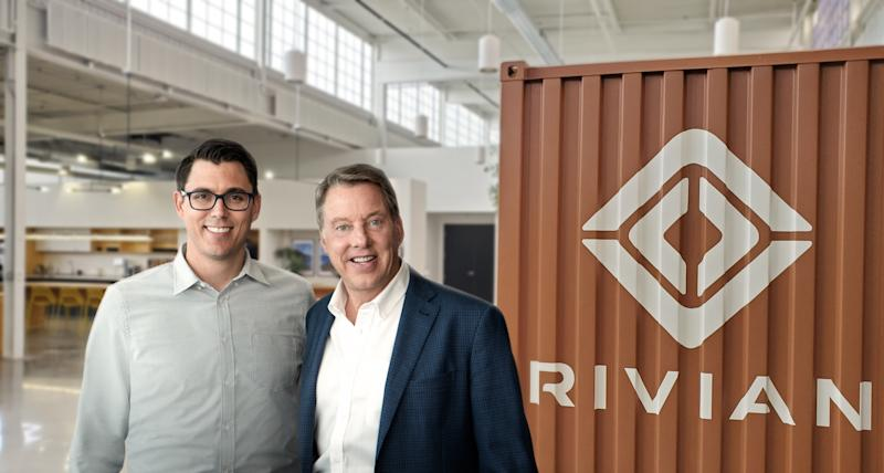 Rivian CEO RJ Scaringe and Ford Executive Chairman Bill Ford are shown together at a Rivian facility