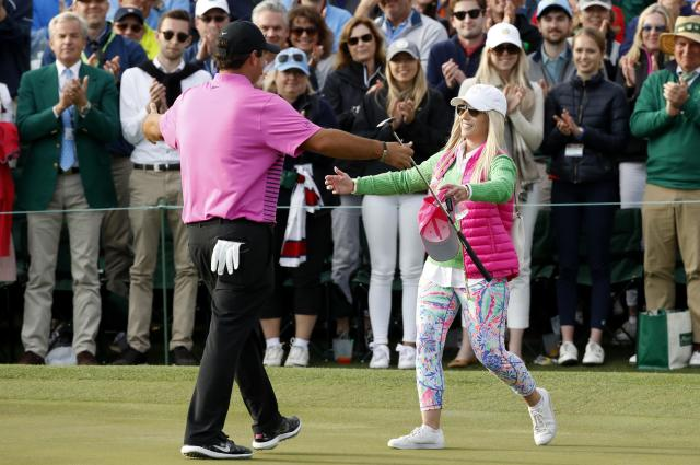 Patrick Reed of the U.S. prepares to hug his wife Justine as he celebrates winning the 2018 Masters after final round play at the Augusta National Golf Club in Augusta, Georgia, U.S. April 8, 2018. REUTERS/Mike Segar