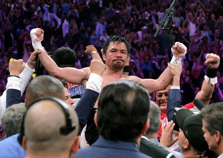 Two judges scored it 115-112 for Pacquiao with the third scoring it 114-113 for Thurman (AFP Photo/John Gurzinski)