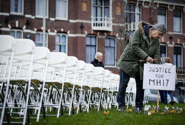 PHOTO: Relatives of victims of the Malaysia Airlines flight MH17 crash hold a silent protest with 298 empty seats in front of the Russian embassy in The Hague, The Netherlands, March 8, 2020. (Robin Van Lonkhuijsen/EPA via Shutterstock)