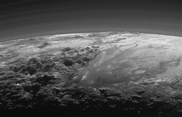 A close-up view of the icy mountains and flat ice plains on Pluto in this photo released Sept. 17 (Reuters)