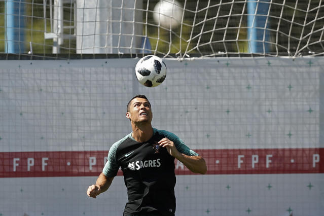 Portugal's Cristiano Ronaldo heads the ball during the training session of Portugal at the 2018 soccer World Cup in Kratovo, outskirts Moscow, Russia, Friday, June 22, 2018. (AP Photo/Francisco Seco)