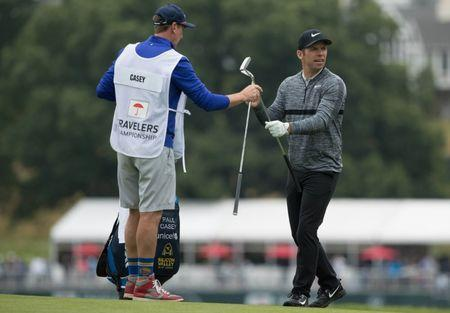 Jun 23, 2018; Cromwell, CT, USA; Paul Casey takes a club from his caddie John McLaren on the 2nd hole during the third round of the Travelers Championship at TPC River Highlands. Mandatory Credit: Bill Streicher-USA TODAY Sports