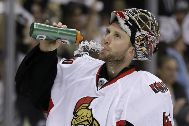 Ottawa Senators goalie Craig Anderson (41) takes drink after allowing a goal to Pittsburgh Penguins' Chris Kunitz in the second period of Game 1 of an NHL hockey Stanley Cup second-round playoff series against the Pittsburgh Penguins in Pittsburgh Tuesday, May 14, 2013. The Penguins won 4-1. (AP Photo/Gene J. Puskar)