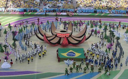 Brazilian singer Claudia Leitte performs on a platform during the 2014 World Cup opening ceremony in Sao Paulo