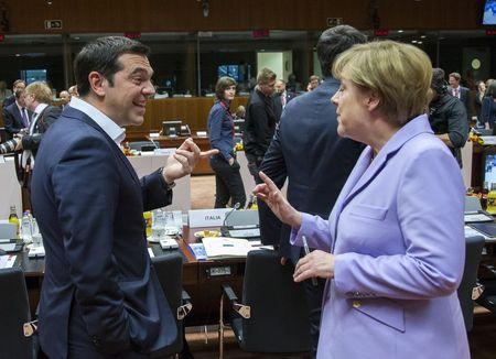 Greek Prime Minister Alexis Tsipras (L) talks with German Chancellor Angela Merkel at a European Union leaders summit in Brussels, Belgium, June 25, 2015.  REUTERS/Yves Herman