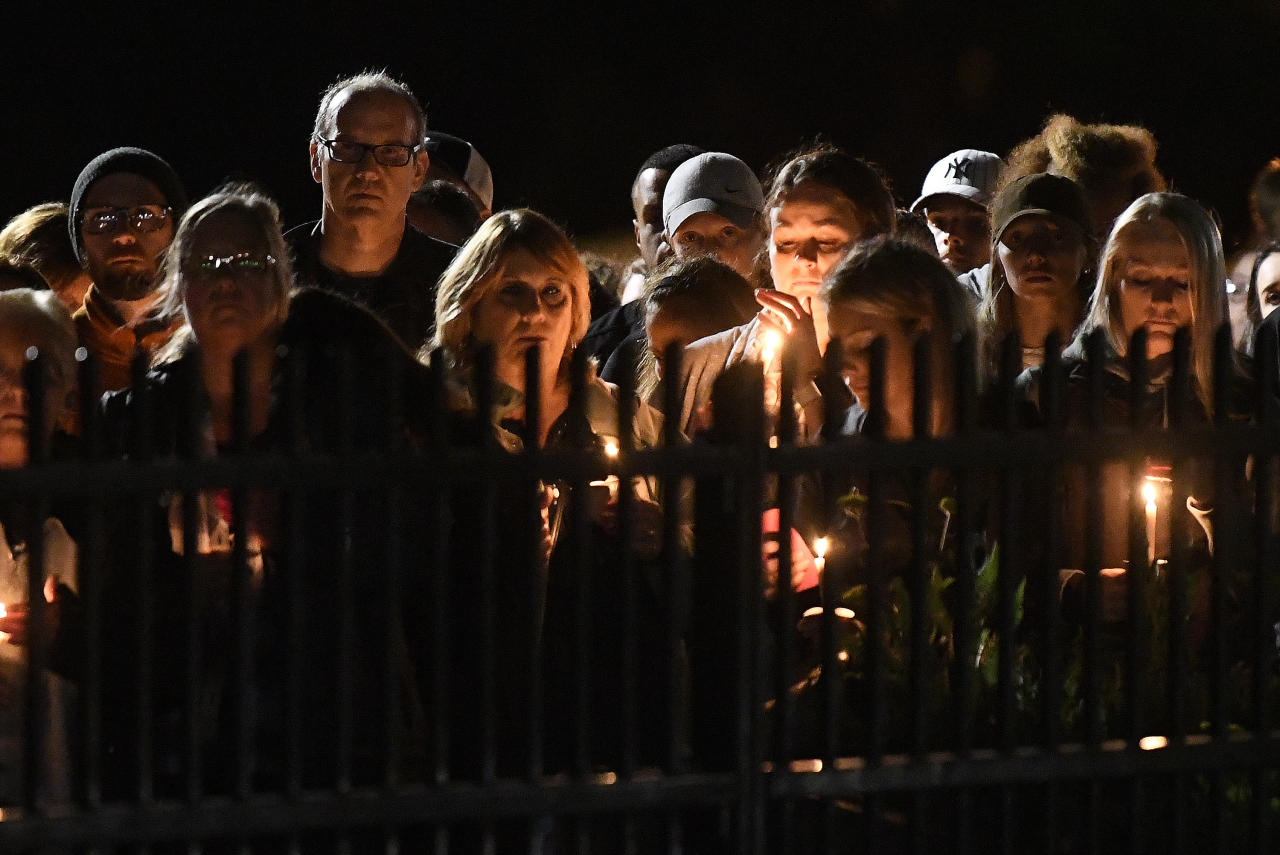 FILE - In this Oct. 9, 2018, file photo family members and friends gather for a candlelight vigil in Amsterdam, N.Y. The memorial honored 20 people who died in Saturday's fatal limousine crash in Schoharie, N.Y. Political leaders in New York have reached an agreement to pass new limousine safety bills inspired by deadly crashes in 2015 and 2018, officials said Tuesday, Jan. 14, 2020. (AP Photo/Hans Pennink, File)