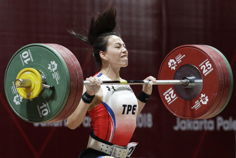 Gold medalist Taiwan's Hsingchun Kuo makes her last attempt to beat her own record during the women's 58kg weightlifting at the 18th Asian Games in Jakarta, Indonesia, Thursday, Aug. 23, 2018. Kuo placed gold. (AP Photo/Aaron Favila)