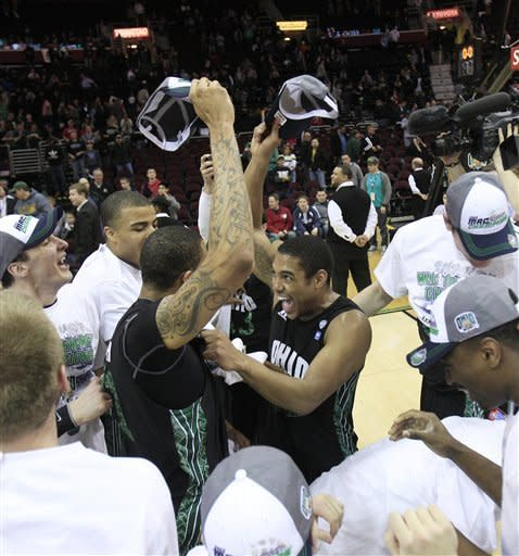 Ohio teammates celebrate after defeating Akron 64-63 in an NCAA college basketball championship game in the Mid-American Conference men's tournament on Saturday, March 10, 2012, in Cleveland. (AP Photo/Tony Dejak)