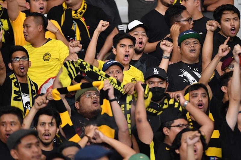 Youth and Sports Minister Syed Saddiq Abdul Rahman shouts slogans during the Fifa World Cup preliminary qualification round 2 between Malaysia and Indonesia at Gelora Bung Karno stadium in Jakarta September 5, 2019. — AFP pic