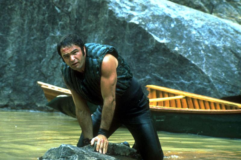 "This image released by Warner Bros. Entertainment shows actor Burt Reynolds portraying Lewis Medlock in the 1972 film ""Deliverance."" Four decades ago, the lush northeast Georgia mountains were introduced to the world in the hit film ""Deliverance.""  Though many in the region still bristle at the movie's portrayal of locals as uneducated, toothless hillbillies who sodomize visitors from the big city, the film helped create the $20 million rafting and outdoor sports industry along the Chattooga River, which splits Georgia and South Carolina and was the fictional Cahulawassee River in the movie. That's why the communities along the Chattooga are celebrating the 40th anniversary of the movie's release with this weekend's first ever Chattooga River Festival.  (AP Photo/Warner Bros. Entertainment)"