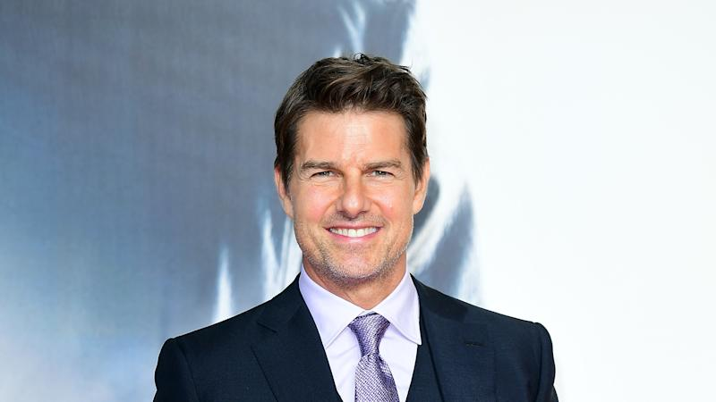 Tom Cruise dons a mask as he returns to cinema for Tenet screening in London