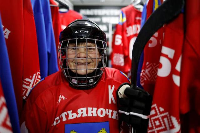 Valentina Fyodorova, 80, the captain of a senior women's hockey team, poses for a photo before a match in Bereznik