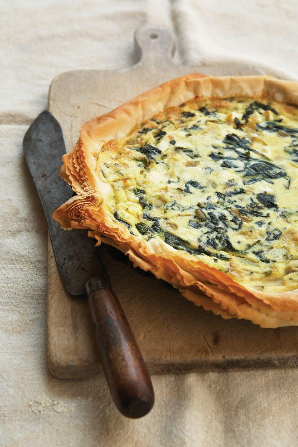 """<p>Chunky chopped pesto and creamy ricotta combine in a flaky phyllo dough crust.</p><p><strong><a href=""""https://www.countryliving.com/food-drinks/recipes/a2414/pesto-ricotta-pie-recipe/"""" rel=""""nofollow noopener"""" target=""""_blank"""" data-ylk=""""slk:Get the recipe"""" class=""""link rapid-noclick-resp"""">Get the recipe</a>.</strong><span class=""""gallery-slide--copyright""""><br></span></p>"""