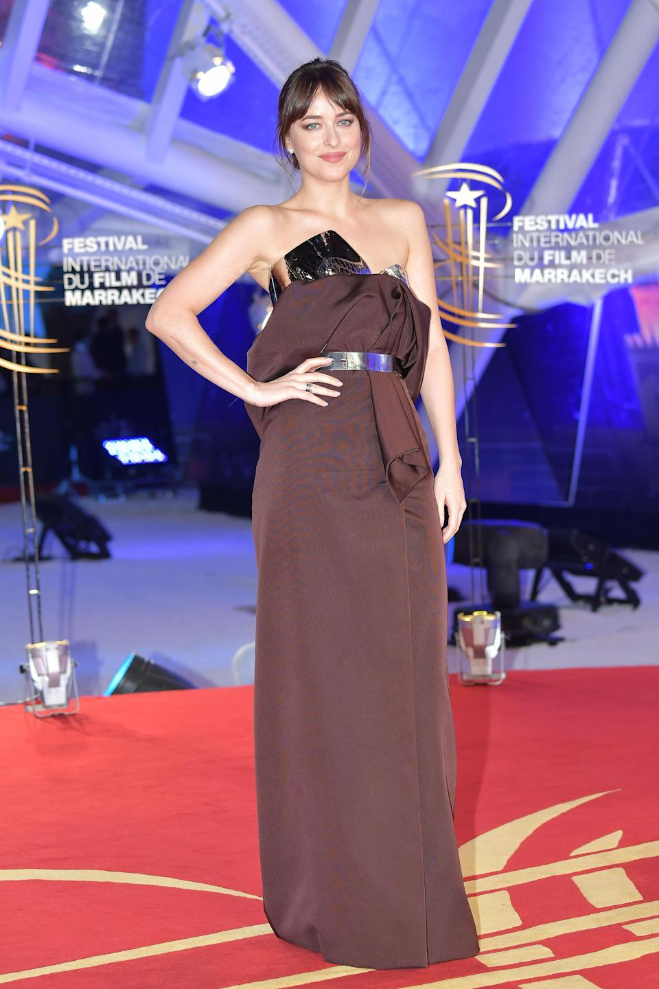 <p>For another premiere, Dakota wore a catwalk-fresh, strapless Givenchy look. <em>[Photo: Getty]</em> </p>