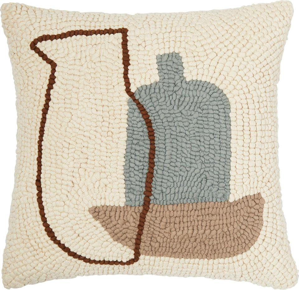 """<p>Made by artisans in India using an intricate loop embroidery technique, the 'Cochato' linen and cotton cushion cover highlights the beauty of traditional craftsmanship and brings a layer of cosy texture to interiors. £95, <a href=""""https://www.conranshop.co.uk/"""" rel=""""nofollow noopener"""" target=""""_blank"""" data-ylk=""""slk:conranshop.co.uk"""" class=""""link rapid-noclick-resp"""">conranshop.co.uk</a></p>"""