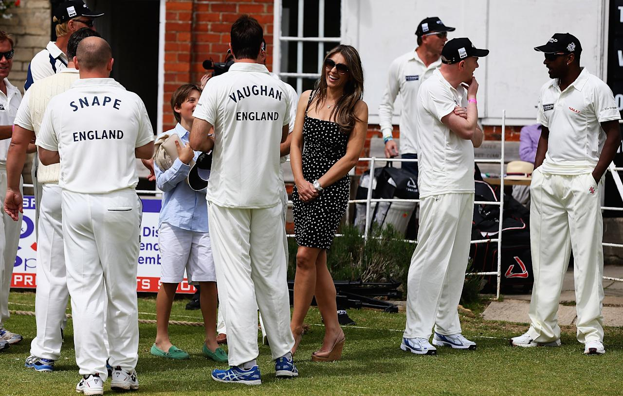 CIRENCESTER, ENGLAND - JUNE 09:  Elizabeth Hurley talks to Michael Vaughan during the Shane Warne's Australia vs Michael Vaughan's England T20 match at Circenster Cricket Club on June 9, 2013 in Cirencester, England.  (Photo by Matthew Lewis/Getty Images)