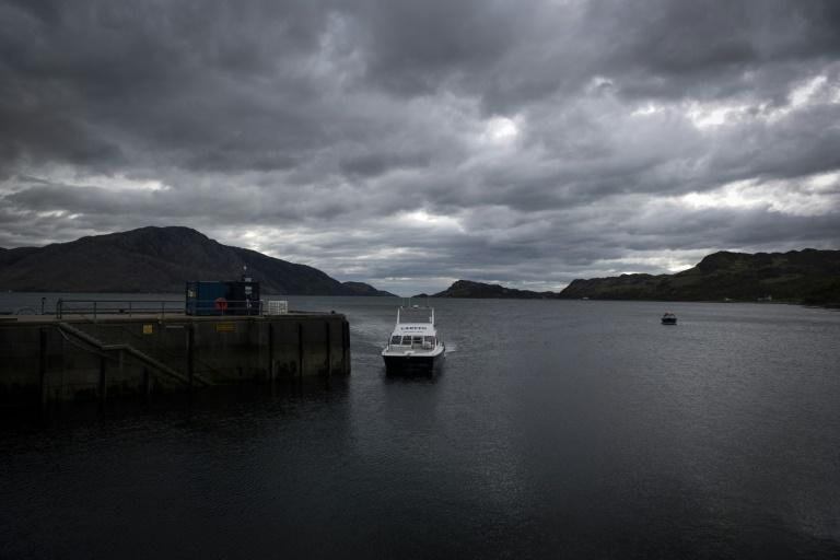 A boat arrives at Inverie, which has no road leading in or out and home to a tightknit community looking to buy their local watering hole