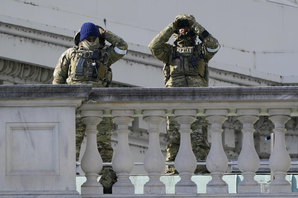 FBI offoicers work security after the after the Inauguration of President Joe Biden on the East Front of the Capitol after inauguration ceremonies, in Washington, Wednesday, Jan. 20, 2021. (AP Photo/J. Scott Applewhite)