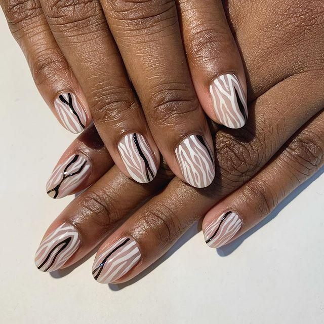 """<p>If you don't know <a href=""""https://www.cosmopolitan.com/style-beauty/beauty/how-to/a5101/things-about-painting-your-nails-you-might-not-know/"""" rel=""""nofollow noopener"""" target=""""_blank"""" data-ylk=""""slk:how to paint your nails"""" class=""""link rapid-noclick-resp"""">how to paint your nails</a> and can't paint a straight line to save your life, you're in luck because zebra stripes are <em>everrrywhere</em> right now and <strong>super-easy to DIY</strong>. Squiggly lines FTW.</p><p><a href=""""https://www.instagram.com/p/CIZa8SWjXuN/?utm_source=ig_embed&utm_campaign=loading"""" rel=""""nofollow noopener"""" target=""""_blank"""" data-ylk=""""slk:See the original post on Instagram"""" class=""""link rapid-noclick-resp"""">See the original post on Instagram</a></p>"""