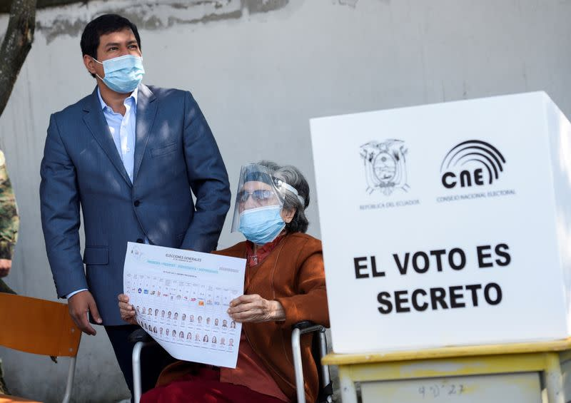FILE PHOTO: FILE PHOTO: Ecuadorean presidential candidate Arauz stands next to his grandmother