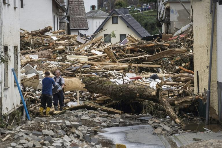 Streets in towns like Germany's Schuld are choked with debris from the sudden floods