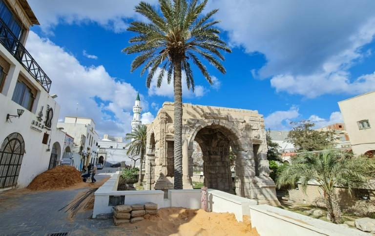 Labourers work near the Marcus Aurelius arch in Tripoli's old city