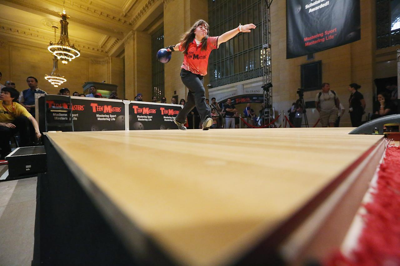 Ashley Dunn bowls during a warmup in the 2012 Teen Masters Bowling Championship in Grand Central Terminal on August 7, 2012 in New York City. (Photo by Mario Tama/Getty Images)