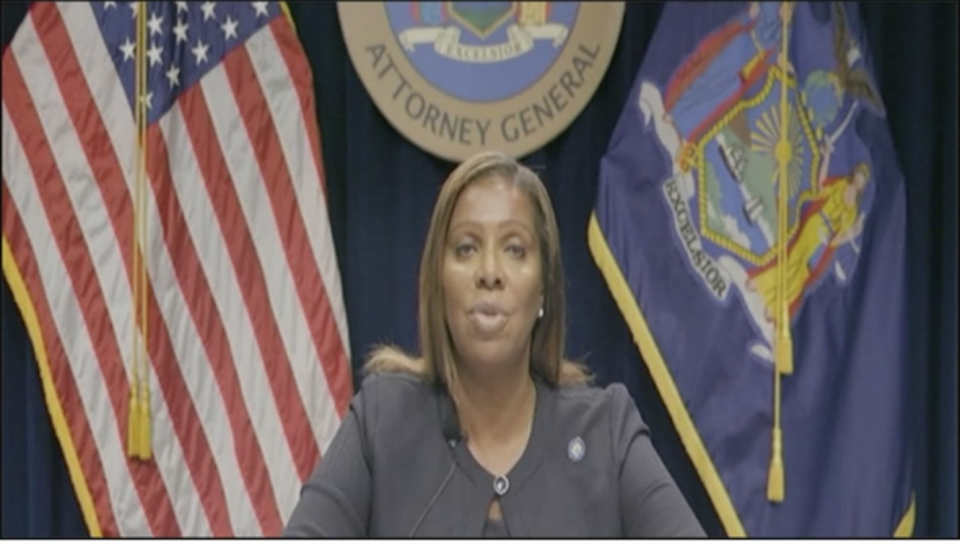 Screenshot of New York Attorney General James sitting in front of the USA and New York flags.