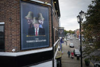"""LIVERPOOL, ENGLAND - OCTOBER 14: Britain's Prime Minister Boris Johnson, Britain's Health Secretary Matt Hancock and Number 10 special advisor Dominic Cummings, are pictured on a sign outside the James Atherton Pub in New Brighton' which has been re-named """"The Three Bellends"""" in protest against new local lockdown measures in New Brighton on October 14, 2020 in Liverpool, England. The Liverpool City Region was placed into the highest tier of the government's new three-tier system to assess Covid-19 risk, a designation which forced the area to close pubs and ban household mixing, among other restrictions. (Photo by Christopher Furlong/Getty Images)"""